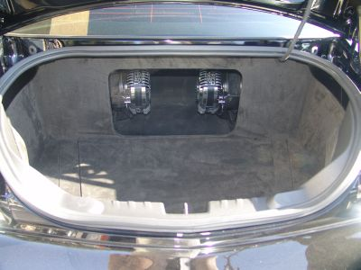 Two TREO SSp Subwoofers in suede-lined trunk with amp covers in place