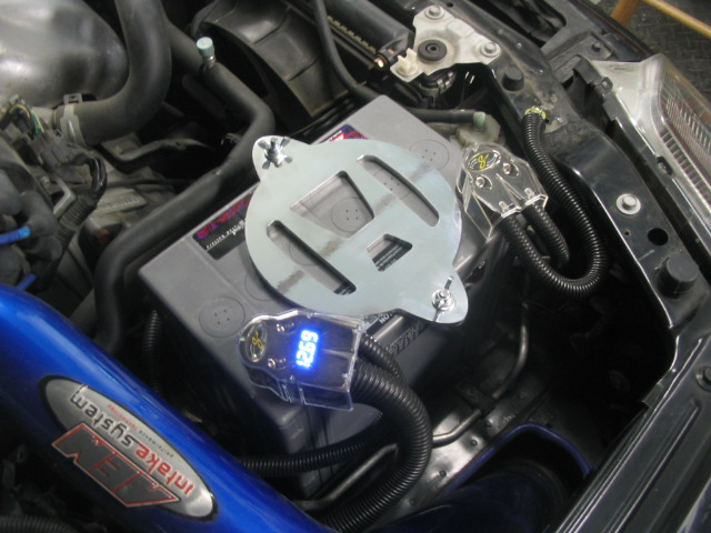 Honda logo battery hold-down with SVR battery and Stinger voltage display